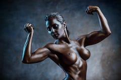 Strong woman bodybuilder Royalty Free Stock Photos