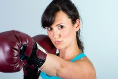 Strong woman with boxing gloves Stock Photos