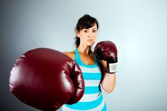 Strong woman with boxing gloves Royalty Free Stock Images