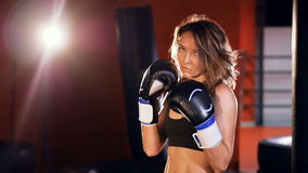 Strong woman in a boxing stance. Slow motion. stock footage
