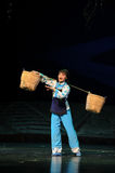Strong woman is carrying a heavy burden- Jiangxi opera a steelyard Royalty Free Stock Image