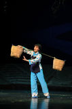 Strong woman is carrying a heavy burden- Jiangxi opera a steelyard Stock Photography