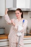 Strong woman cleaning kitchen Royalty Free Stock Image