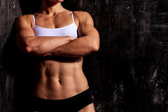 Strong woman on a dark background Stock Photo