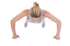 Strong woman doing press ups stock image