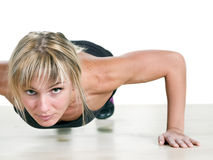Strong woman doing push-up Royalty Free Stock Images