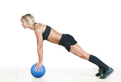 Strong woman doing push-up on a ball Royalty Free Stock Images