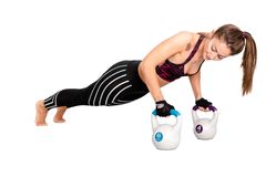 Strong woman doing push-ups on kettle bell. Image stock image