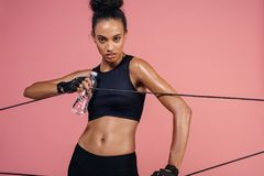 Strong woman exercising with elastic band Stock Image