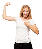 Strong woman. Female showing biceps stock photography
