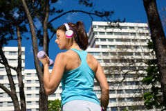 Strong woman on fitness workout in city park Stock Photo