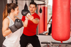 Strong woman getting boxing lessons Royalty Free Stock Photo