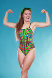 Strong woman girl in swimsuit showing off muscles. Stock Image