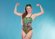 Strong woman girl in swimsuit showing off muscles. Stock Images