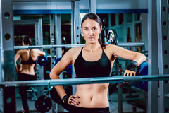 The strong woman in the gym Stock Image