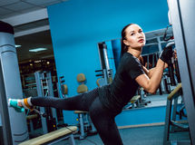 The strong woman in the gym Stock Photos