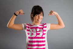 Strong woman. Happy with their strength stock photography