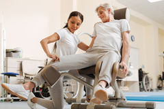 Strong woman helping her visitor in exercise Royalty Free Stock Photography
