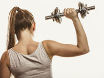 Strong woman lifting dumbbells weights. Fitness. Royalty Free Stock Images