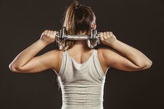 Strong woman lifting dumbbells weights. Fitness. Strong woman lifting dumbbells weights. Fit girl exercising gaining building muscles. Fitness and bodybuilding stock images
