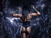 Strong woman. Muscular strong woman prisoner in mountains Royalty Free Stock Photo