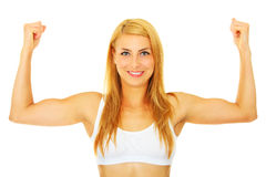 Strong woman. A picture of a young strong woman showing her muscles over white background royalty free stock images