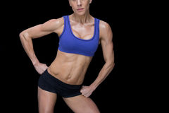 Strong woman posing in sports bra and shorts Royalty Free Stock Photo