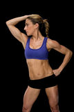 Strong woman posing in sports bra and shorts Royalty Free Stock Photography