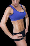 Strong woman posing in sports bra and shorts Stock Photography