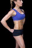Strong woman posing in sports bra and shorts Royalty Free Stock Photos