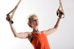 Strong woman pulling fitness cords Stock Photos