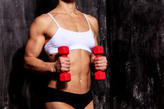Strong woman with red barbells Stock Photo