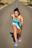 Strong woman running in country road Stock Photography