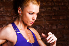 Strong woman. Is running and listening music royalty free stock image