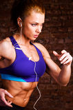 Strong woman. Is running and listening music stock photos