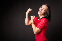 Strong woman showing her strength Royalty Free Stock Image