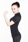 Strong woman showing off muscles. Royalty Free Stock Photography