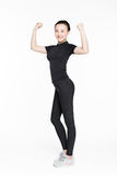 Strong woman showing off muscles. Stock Photography