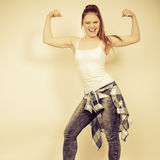 Strong woman showing off muscles. Strength. Royalty Free Stock Image