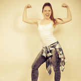 Strong woman showing off muscles. Strength. Stock Images