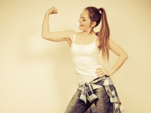 Strong woman showing off muscles. Strength. Royalty Free Stock Photography