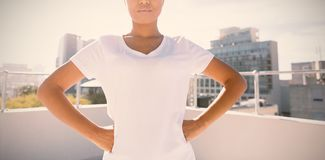Strong woman standing for breast cancer awareness stock photography