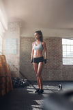 Strong woman standing in crossfit gym Royalty Free Stock Photo