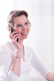 Strong woman is talking on the phone Royalty Free Stock Photos