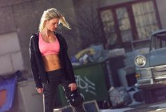 Strong Woman with Toned Body in the Neighborhood Royalty Free Stock Photo