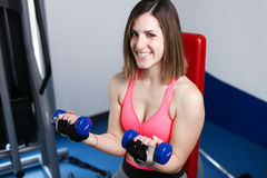 Strong woman weightlifting at the gym looking Stock Image