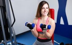 Strong woman weightlifting at the gym looking Stock Photos