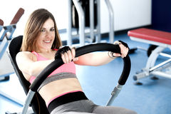 Strong woman weightlifting at the gym looking Stock Photo