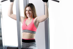 Strong woman weightlifting at the gym looking Stock Photography