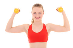 Strong woman with yellow dumbbells Stock Photos